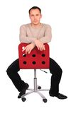 Young man sits on chair Stock Image