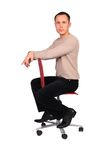 Young man sits on chair sideview Stock Photography