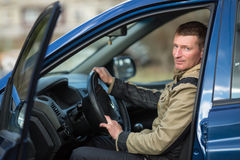 A young man sits in his new car. Hobby. royalty free stock photos