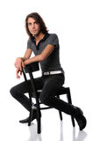 Young Man Sittin on Black Chair Stock Photography