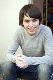 Young man sitting Stock Photos