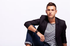 Young man sitting Royalty Free Stock Images