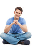 Young man sitting Stock Image