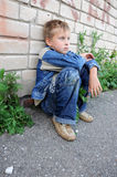 Young man sitting. Against graffiti Royalty Free Stock Photography