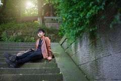 Young man sitting alone among the nature Stock Images