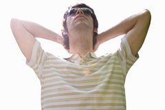 Young man sitting back in sunglasses, relaxed, cut out Royalty Free Stock Photography