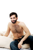 Young man sitting on the bed. Stock Photography