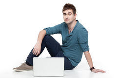 Young man sitting behind laptop Stock Photography