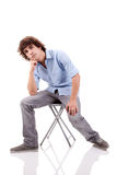 Young man, sitting on a bench Royalty Free Stock Photography