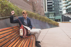 Young man sitting on a bench Royalty Free Stock Images