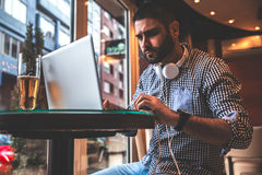 Young man sitting at the cafe Stock Photography