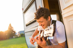 Young man sitting in a camper van Royalty Free Stock Photo