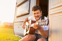 Young man sitting in a camper van Royalty Free Stock Image