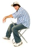 Young Man Sitting in Chair Stock Images