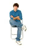 Young Man Sitting in Chair Stock Photos