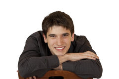 Young man sitting on a chair Stock Image