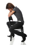 Young Man Sitting On Chair Stock Image