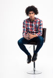 Young man sitting on the chair Royalty Free Stock Photos