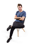 young man sitting on the chair Royalty Free Stock Photography