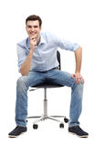 Young man sitting in chair Royalty Free Stock Images