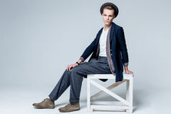 Young man sitting on chair Royalty Free Stock Photos