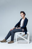 Young man sitting on chair Royalty Free Stock Images