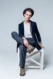 Young man sitting on chair Stock Photo