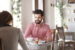 Young man sitting in coffee shop Stock Images