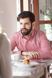 Young man sitting in coffee shop Royalty Free Stock Photo