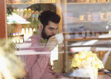 Young man sitting in coffee shop Stock Photo