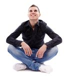 Young man sitting cross legged Stock Photography