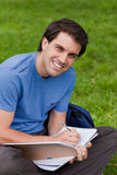 Young man sitting cross-legged while working Royalty Free Stock Image