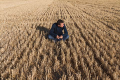 Young Man Sitting in Field Royalty Free Stock Photo