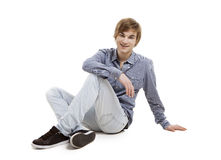 Young man sitting on the floor Royalty Free Stock Images