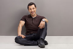 Young man sitting on the floor Royalty Free Stock Image