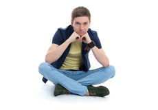 Young man sitting on the floor with legs crossed Royalty Free Stock Photos