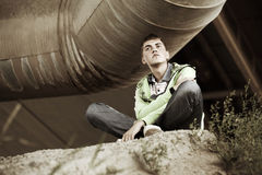 Young man sitting on the ground Royalty Free Stock Photos