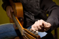 Young man sitting guitar tuning Royalty Free Stock Images