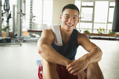 Young man sitting in the gym, portrait Stock Images