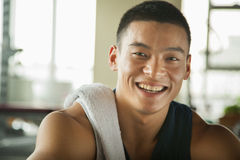 Young man sitting in the gym, portrait Royalty Free Stock Photo
