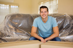 Young man sitting Stock Photography