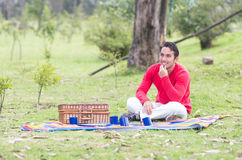 Young man sitting having a picnic Royalty Free Stock Photo