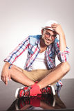 Young man sitting with his legs crossed Royalty Free Stock Images