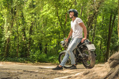 Young man sitting on his motorbike Royalty Free Stock Images