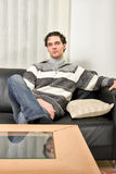 Young man is sitting at home alone Stock Photo