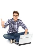 Young man sitting with laptop Stock Image