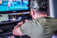 Retro gamer in front of the TV Royalty Free Stock Image