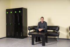 Young Man Sitting on Leather Sofa Locker Room Royalty Free Stock Photos