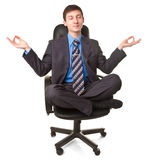 Young man sitting in lotus pose Royalty Free Stock Photos