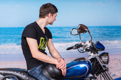 Young Man Sitting on Motorcycle at Beach Royalty Free Stock Photos